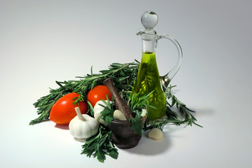 Tomatoes, garlic, olive oil and  herbs for sauce preparation