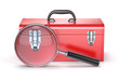 Red toolbox with magnifying glass
