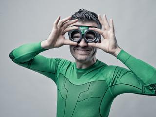 Superhero adjusting glasses
