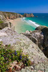 Sea cliffs over beach in Porthcurno, Cornwall, UK.
