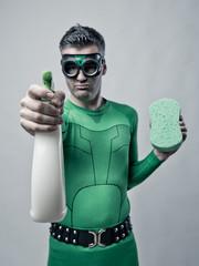Superhero with detergent and sponge
