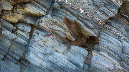 Colored granite and schist rock face