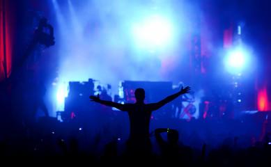 Silhouette of a man enjoying a concert