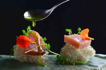 Fine dining, fresh raw ahi tuna sashimi served on sponge