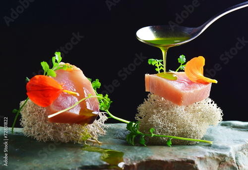 Fine dining, fresh raw ahi tuna sashimi served on sponge