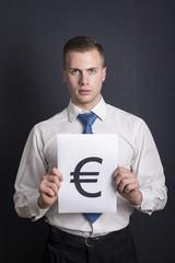 Businessman holding Euro sign