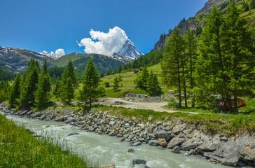 Flowing stream near, Matterhorn, the top of Swiss Alps