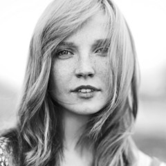 Portrait of attractive young woman outdoors. Black & white