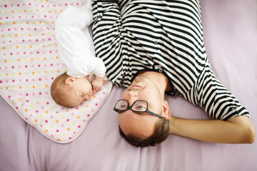 Father with newborn baby at home
