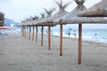 sandy beach sunbeds umbrellas sea