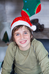 Young boy home wear red christmas santa hat
