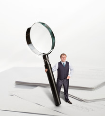 Businessman with big loupe