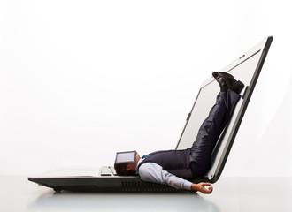 Man lies on laptop