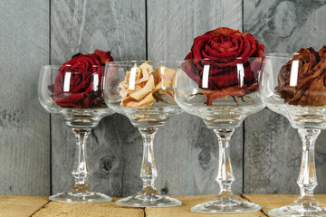 Glasses with roses symbolize wine