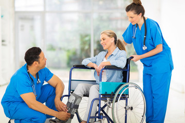 doctor talking to a recovering patient in wheelchair