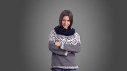 Young beautiful girl turns in  sweater with alpha channel