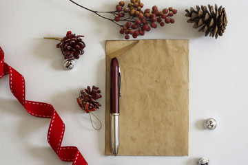 old paper, red ribbon and Christmas baubles