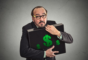 Money greed wealth security concept. Man with briefcase of cash