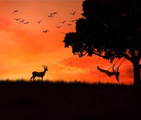 woman on swing of tree isolated sunset evening dusk sky