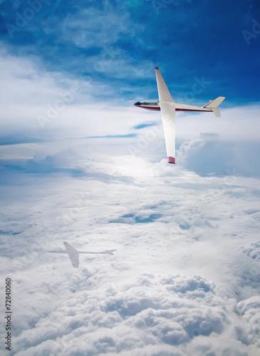 Leinwandbild Motiv Flight deltaplane clouds
