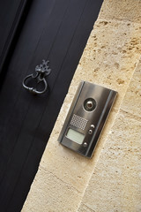 Door knocker and intercom on a facade of a French house