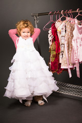 Young girl trying on a white dress