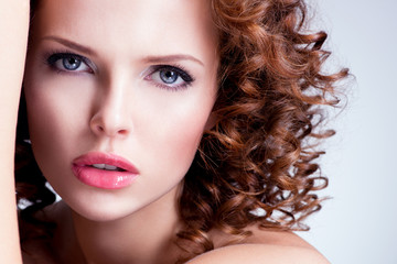 Beautiful brunette young woman with bright make up.