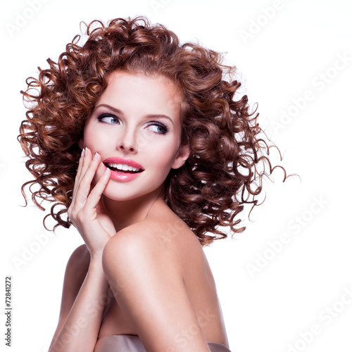 canvas print picture Beautiful smiling thoughtful woman with curly hair.