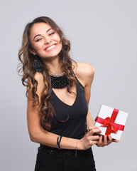 Young woman happy smile hold gift box in hands, isolated over