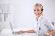 Portrait of beautiful businesswoman working at her desk with - 72843038