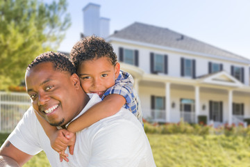 African American Father and Mixed Race Son, House Behind