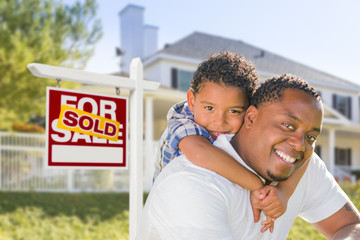 African American Father and Mixed Race Son, Sold Sign, House