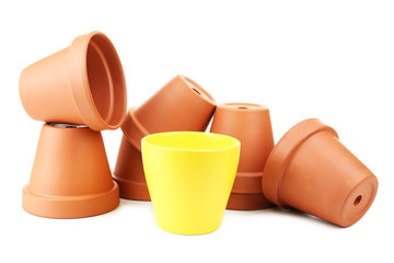 Individuality concept. Flowerpots isolated on white