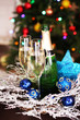Christmas decorations and champagne bottle and glasses