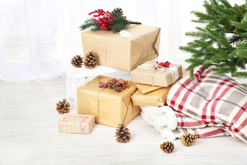 Christmas presents and decorations in boxes near Christmas tree