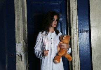 Horror Scene of woman which holding bear