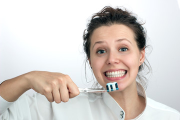 Smiling girl with a  toothbrush