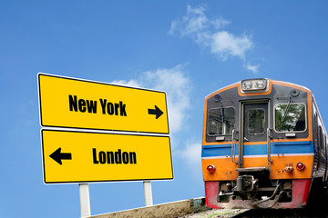 Train and road sign board to New York and London
