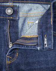 Texture of  blue denim jeans with button and zip