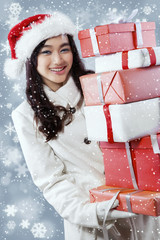 Beautiful girl carrying many presents