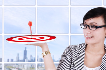 Businesswoman holding a target