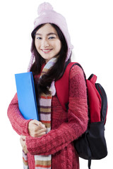 Gorgeous student wearing winter clothes in studio