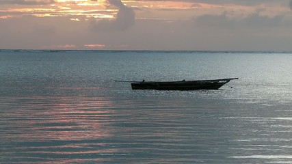 Traditional wooden boat at sunrise,  Zanzibar