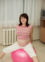 Pregnant woman in childbirth. Pregnant woman with gymnastic ball