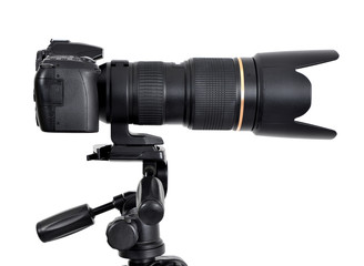 DSLR camera with zoom lense on a tripod isolated