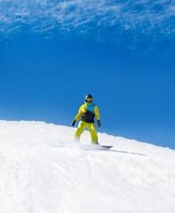 Snowboarder sliding down hill, snow snowboarding