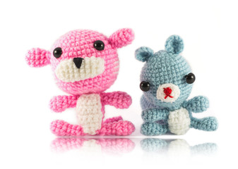 handmade crochet pink tiger and Raccoon doll on white background
