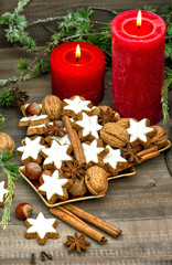 cinnamon cookies, nuts and spieces with christmas decoration