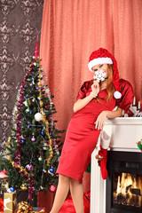 Beautiful woman decorating the Christmas tree