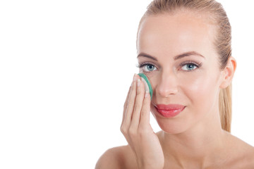 woman removing face make-up with cotton swab pad